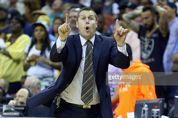 Dave Joerger the head coach of the Memphis Grizzlies gives instructions to his team against the Oklahoma City Thunder during Game 3 of the Western...