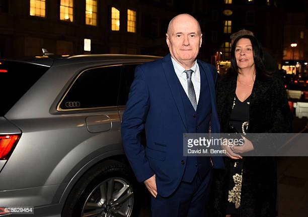 Dave Johns and guest arrive in an Audi at the Evening Standard Film Awards 2016 on December 8 2016 in London England