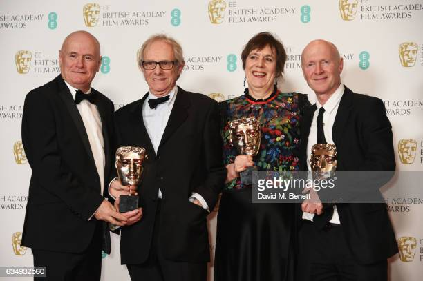 Dave Johns Ken Loach Rebecca O'Brien and Paul Laverty accepting the Outstanding British Film award for 'I Daniel Blake' pose in the winners room at...