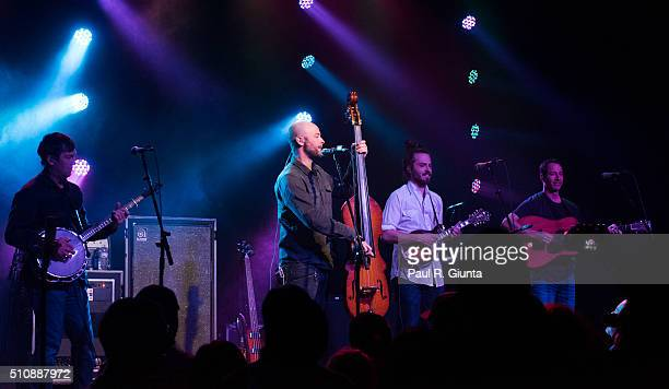 Dave Johnston Ben Kaufmann Jake Joliff and Adam Aijala of Yonder Mountain String Band perform on stage at The Variety Playhouse on February 13 2016...