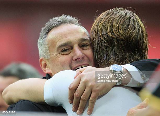 Dave Jones manager of Cardiff hugs Glenn Loovens of Cardiff during the FA Cup sponsored by EON SemiFinal match between Barnsley and Cardiff City at...