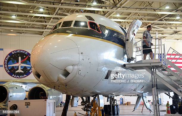 Dave Jordan Mission Manager NASA Earth Science Project Office steps out of NASA's highly modified Douglas DC8 jetliner which operates as a flying...