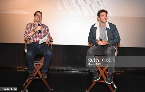 Dave Karger and Bradley Cooper speak onstage during 'A Star Is Born' Atlanta screening at Regal Atlantic Station on September 13 2018 in Atlanta...