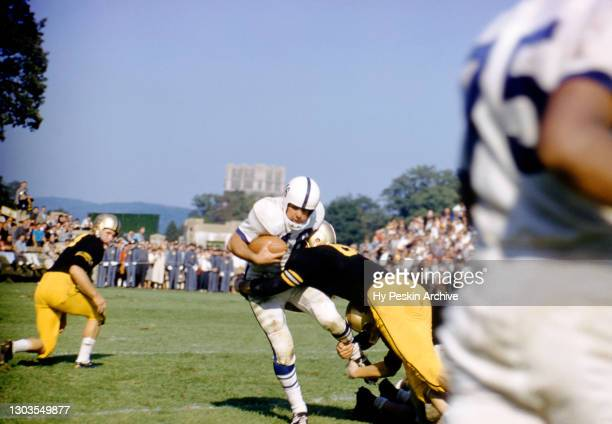 Dave Kasperian of the Penn State Nittany Lions gets tackled during an NCAA game against the Army Cadets on October 4, 1958 at Michie Stadium in West...