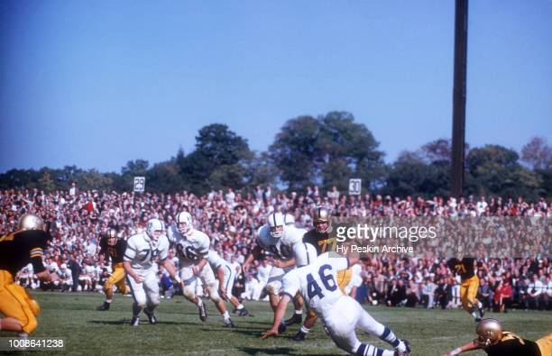 Dave Kasperian of the Penn State Nittany Lions is tackled from behind during an NCAA game against the Army Cadets on October 4 1958 at Michie Stadium...