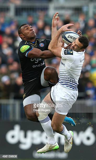 Dave Kearney of Leinster beats Semesa Rokoduguni to the high ball during the European Rugby Champions Cup match between Bath and Leinster at the...