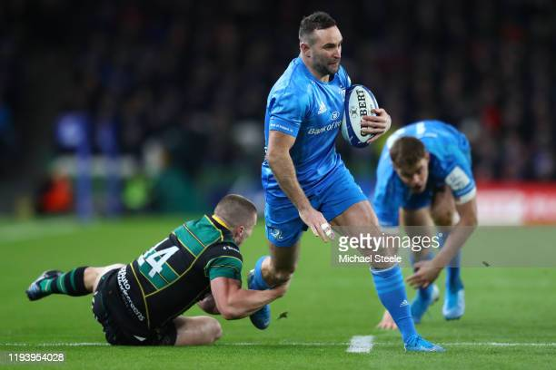 Dave Kearney of Leinster goes past Ollie Sleightholme of Northampton to score a try during the Heineken Champions Cup Round 4 match between Leinster...