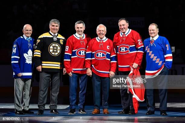 Dave Keon Raymond Bourque Denis Savard Yvan Cournoyer Frank Mahovlich and Rod Gilbert pose for a photo during the pregame ceremony prior to the NHL...