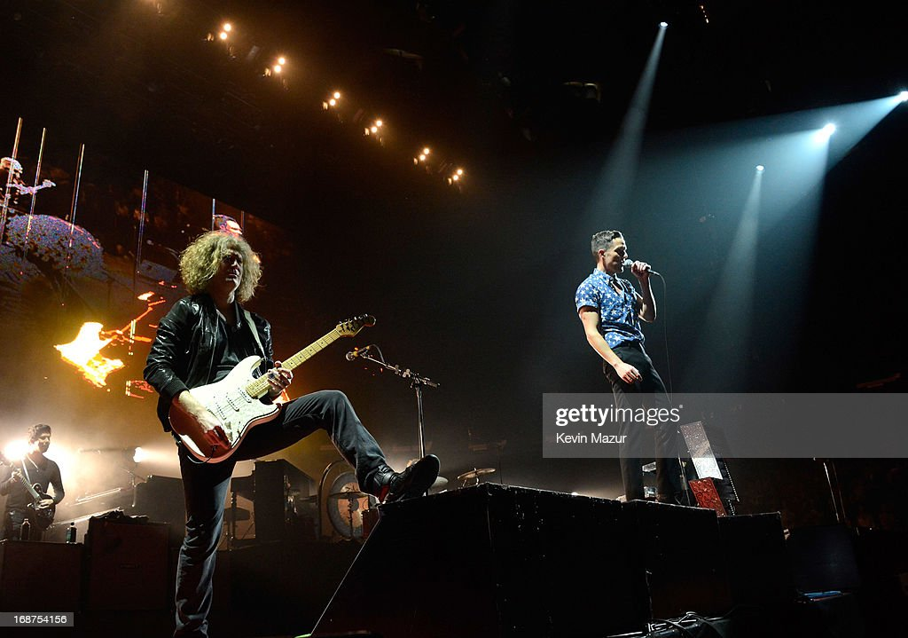 Dave Keuning and Brandon Flowers perform during the Killers 'Battle Born' tour at Madison Square Garden on May 14, 2013 in New York City.