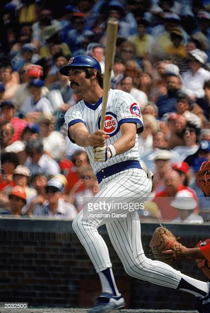 Dave Kingman of the Chicago Cubs swings at the pitch during a game in the 1980 season at Wrigley Field in Chicago Illinois