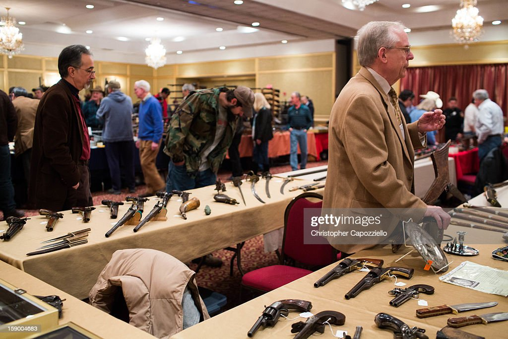 Dave Kleiner, of Gettysburg, Pennsylvania, sells antique guns at a gun show at the Crowne Plaza Hotel on January 5, 2013 in Stamford, Connecticut. While other area gun shows have been canceled following the shooting rampage that killed 20 first-graders and six teachers and administrators in Newtown, Connecticut last month, a gun show held by Westchester Collectors Inc. in Stamford, 30 miles from Newtown, is going on as planned.