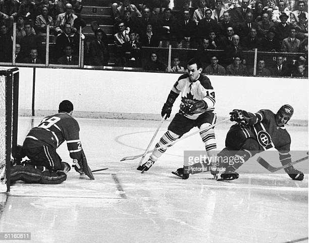 Dave Koen of the Toronto Maple Leafs tries to elude the Montreal Canadien defense and goalkeeper Rogatien Vachon during the second game of the 1967...