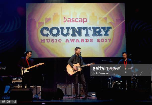 Dave Kuncio Dierks Bentley and Josh Mirenda perform onstage during the 55th annual ASCAP Country Music awards at the Ryman Auditorium on November 6...