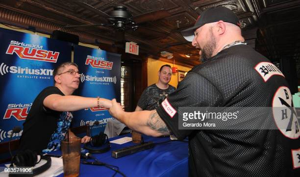 Dave LaGreca and Wrestler Bully Ray greet during SiriusXM's Busted Open Live From WrestleMania 33on April 1 2017 in Orlando City