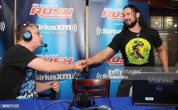 Dave LaGreca and Wrestler Drew Galloway meet during SiriusXM's Busted Open Live From WrestleMania 33on April 1 2017 in Orlando City