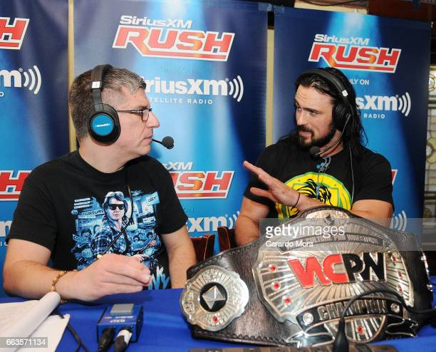 Dave LaGreca and Wrestler Drew Galloway speak during SiriusXM's Busted Open Live From WrestleMania 33on April 1 2017 in Orlando City