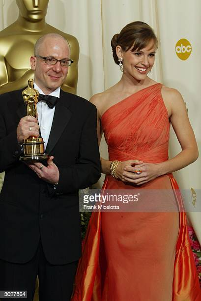 Dave Lebolt accepts the scientific and technical Oscar award for Degidesign next to presenter Jennifer Garner during the 76th Annual Academy Awards...