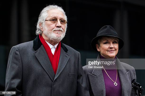 Dave Lee Travis and his wife Marianne Griffin arrive at Southwark Crown Court on March 28 2014 in London England Dave Lee Travis whose real name is...