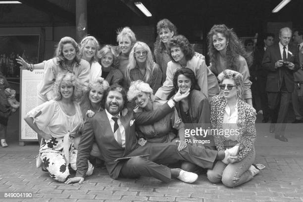 DJ Dave Lee Travis is surrounded by some of the women who appear in his photography book A Bit of a Star Back Row LR Unidentified Janet Ellis...