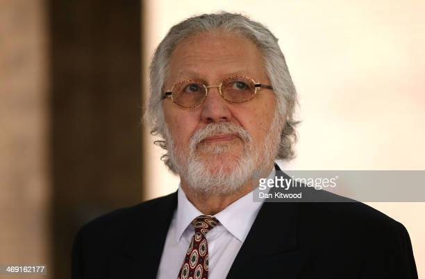 Dave Lee Travis leaves Southwark Crown Court after being found not guilty of 12 counts of indecent assault on February 13 2014 in London England Dave...