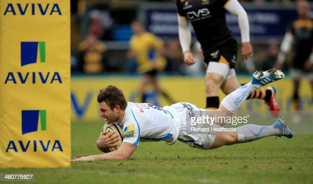 Dave Lewis of Exeter dives over to score the first try during the Aviva Premiership match between London Wasps and Exeter Chiefs at Adams Park on...
