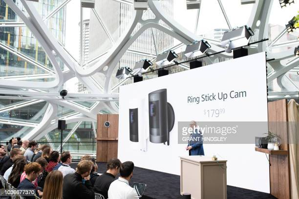 Dave Limp senior vice president of Amazon devices announces Ring's new Stick Up Cams during an Alexa products and services launch event at The...