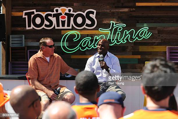 Dave Logan and Terrell Davis answer questions at the Tostitos Stage at the NFL Kickoff Village on September 9 2016 in Denver Colorado