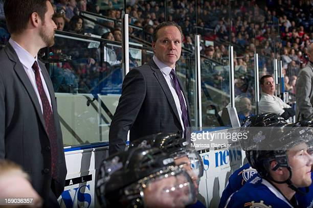Dave Lowry head coach of the Victoria Royals stands on the bench at the Kelowna Rockets on January 2 2013 at Prospera Place in Kelowna British...