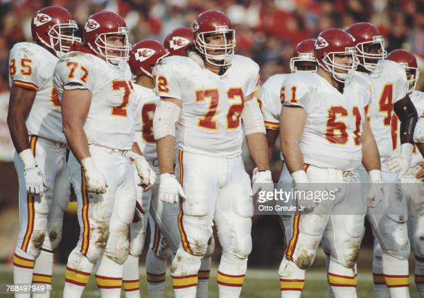 Dave Lutz Offensive Linesman for the Kansas City Chiefs stands with his Center Tim Grunhard and Right Tackle Rich Baldinger during the American...