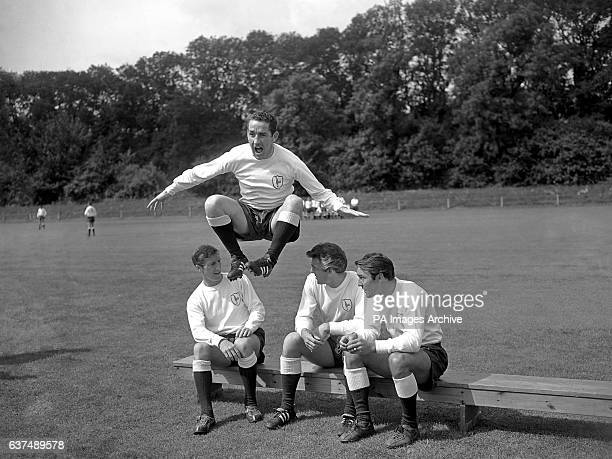 Dave MacKay who broke his leg twice last season demonstrates his fitness by jumping over team mates Ron Henry Cliff Jones and Jimmy Greaves