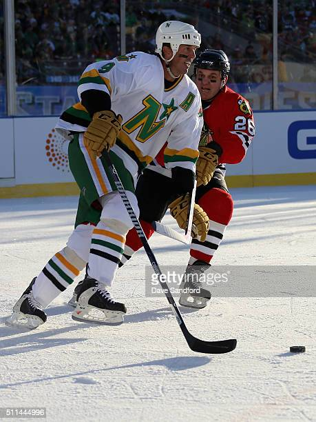 Dave Mackey of the Chicago Blackhawks Alumni skates on defense against Mike Modano of the Minnesota North Stars Alumni during the 2016 Coors Light...