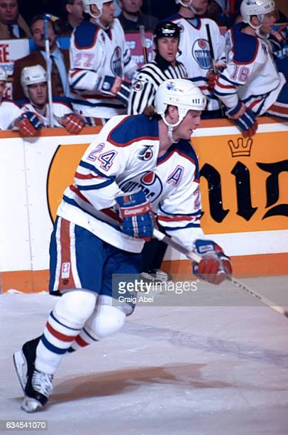 Dave Manson of the Edmonton Oilers controls the puck against the Toronto Maple Leafs during NHL game action on February 16 1992 at Maple Leaf Gardens...