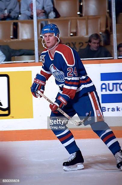 Dave Manson of the Edmonton Oilers watches the play develop against the Toronto Maple Leafs during NHL game action against on December 18 1991 at...