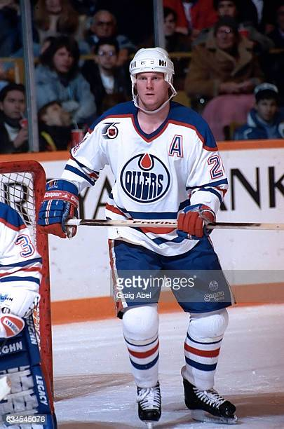 Dave Manson of the Edmonton Oilers watches the play develop against the Toronto Maple Leafs during NHL game action on February 16 1992 at Maple Leaf...