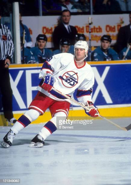 Dave Manson of the Winnipeg Jets skates on the ice during an NHL game against the San Jose Sharks circa 1995 at the Winnipeg Arena in Winnipeg...