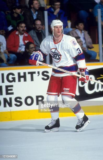 Dave Manson of the Winnipeg Jets skates on the ice during an NHL game circa 1993 at the Winnipeg Arena in Winnipeg Manitoba Canada