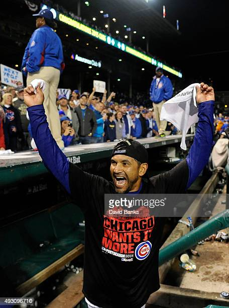 Dave Martinez of the Chicago Cubs celebrates after the Cubs win against the St Louis Cardinals 64 in game four of the National League Division Series...