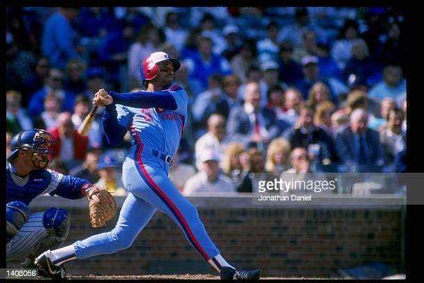 Dave Martinez of the Montreal Expos swings at the ball during a game against the Chicago Cubs at Wrigley Field in Chicago Illinois