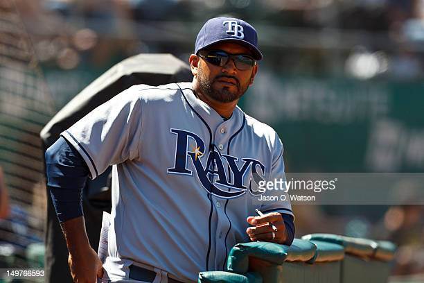 Dave Martinez of the Tampa Bay Rays stands in the dugout during the ninth inning against the Oakland Athletics at Oco Coliseum on August 1 2012 in...
