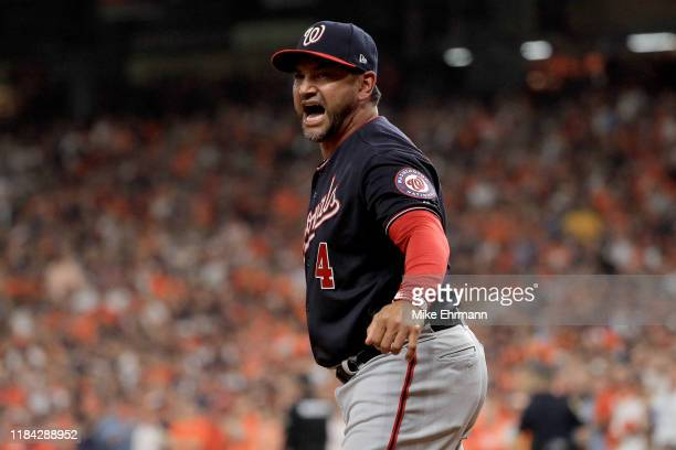 Dave Martinez of the Washington Nationals argues a runner interference call with umpire Sam Holbrook during the seventh inning against the Houston...