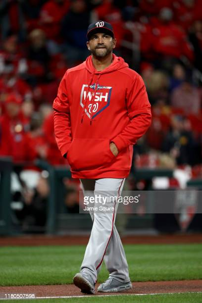 Dave Martinez of the Washington Nationals walks on the field prior to game one of the National League Championship Series against the St Louis...