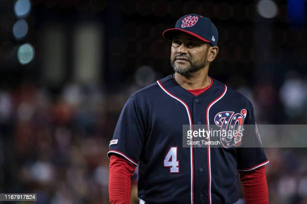 Dave Martinez of the Washington Nationals walks to the dugout against the Atlanta Braves during the eighth inning at Nationals Park on September 13...