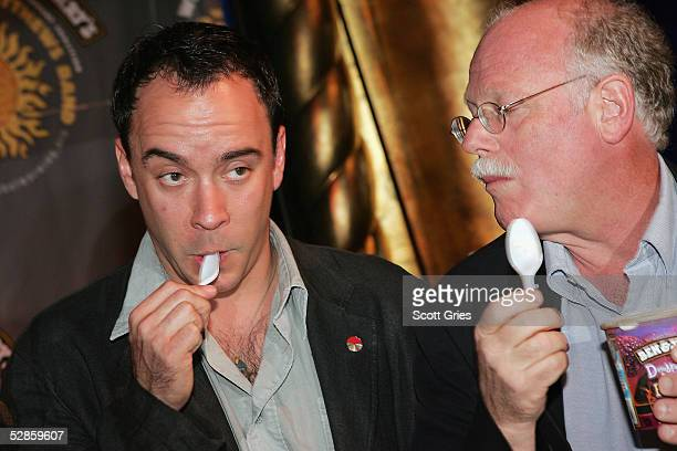 Dave Matthews of The Dave Matthews Band and cofounder of Ben Jerrys Ice Cream Ben Cohen eat ice cream during a press conference to announce a...