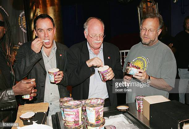 Dave Matthews of The Dave Matthews Band and cofounders of Ben Jerrys Ice Cream Ben Cohen and Jerry Greenfield eat ice cream during a press conference...