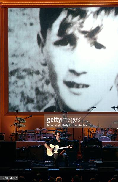 Dave Matthews performs 'In My Life' under a photo of a young John Lennon during 'Come Together A Night for John Lennon's Words Music' at Radio City...
