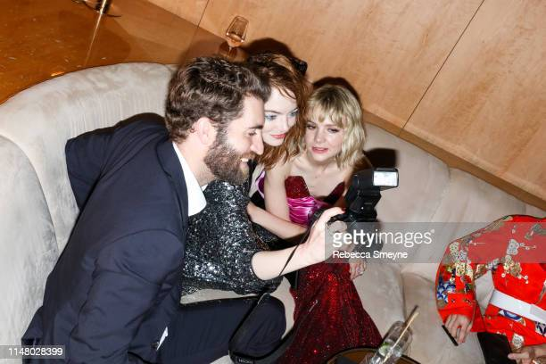 Dave McCary Emma Stone and Carey Mulligan attend the Met Gala Boom Boom Afterparty at Top of the Standard on May 6 2019 in New York City