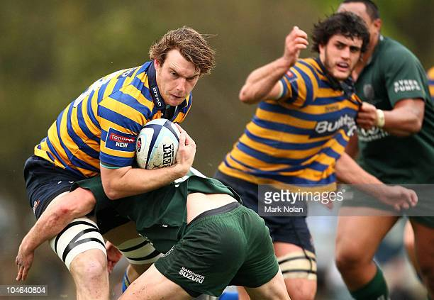 Dave McDuling of Sydney Uni is tackled during the Shute Shield Grand Final match between Randwick and Sydney University at Concord Oval on October 2...