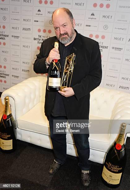 Dave McKean winner of The Raindance Award for Luna poses at The Moet British Independent Film Awards 2014 at Old Billingsgate Market on December 7...