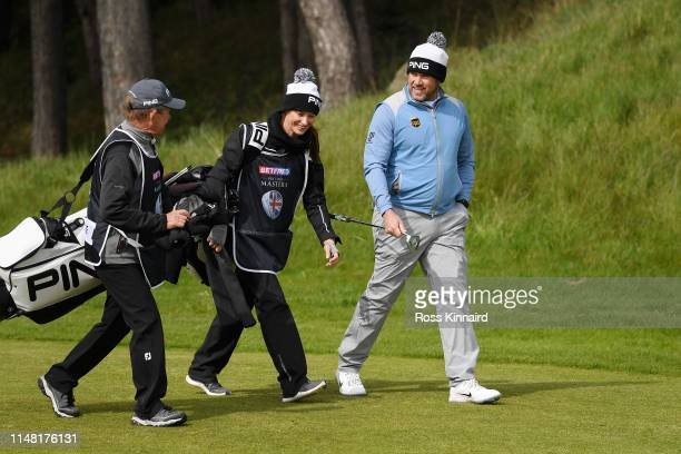 Dave Mcneilly caddie for Matt Wallace Helen Storey caddie for Lee Westwood and Lee Westwood of England walk down the 17th fairway during Day Two of...