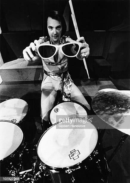 Dave Mount from Mud posed at his drumkit with oversized glasses at Hilversum TV Studios Holland in 1975